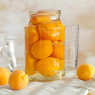 Как приготовить компот из абрикосов и апельсинов на зиму